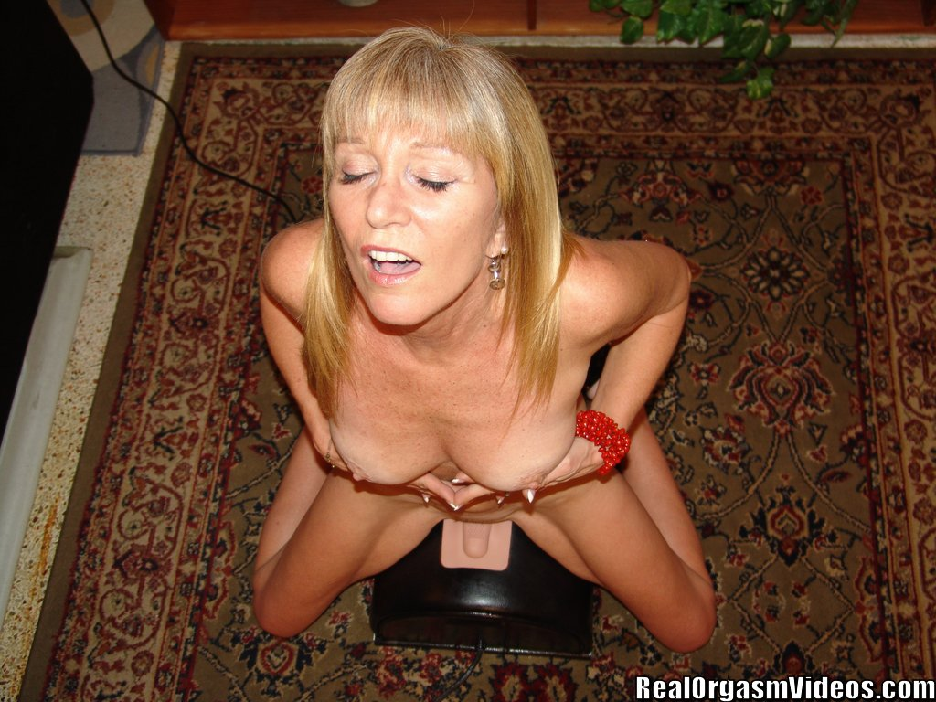 Old woman having sybian orgasm